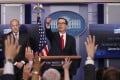IS National Economic Director Gary Cohn (left) and Treasury Secretary Steven Mnuchin unveil the Trump administration's tax reform proposal in the White House briefing room in Washington on Wednesday. Photo: Reuters