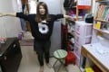 Mother Yan Nga-chi shows off her new-look furniture in her Sham Shui Po home. Photo: Dickson Lee