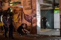 Police officers investigate on the blast site in Quiapo, Manila. Photo: AFP