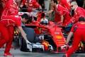 Mechanics push the car of Ferrari Formula One driver Sebastian Vettel of Germany during the qualifying session. Photo: Reuters