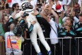Mercedes' Finnish driver Valtteri Bottas celebrates with the team's crew after winning the Formula One Russian Grand Prix at the Sochi Autodrom circuit. Photo: AFP