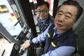 Senior motorman Kong Sin-man (right) and motorman Ho Yiu-man at the Kennedy Town tram depot. Photo: Xiaomei Chen