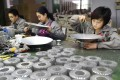 Workers assemble LED lights at a factory in Zouping, in eastern China's Shandong province. Photo: AFP