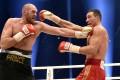 Ukraine's Wladimir Klitschko, right, and Britain's Tyson Fury exchange blows during their bout in Duesseldorf in 2015. Photo: AP