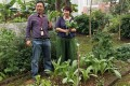 Lily Chan (right) with fellow peer support worker Jecko Cheng Chi-ho in the Castle Peak Hospital garden, where patients can plant crops as a form of therapy. Photo: Emily Tsang