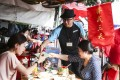 A 3-day vegetarian food festival took place at the Cheung Chau Bun Festival. The practice to refrain from consuming meat during the week-long bun festival to drive off evil spirits. Photo: Sam Tsang