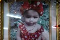 A memorial photograph of slain 11-month old girl Natalie is displayed at a temple in Phuket, Thailand, on April 27. She was murdered by her father who broadcast the killing on Facebook Live, before he killed himself. Photo: AFP