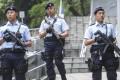 Armed police patrol the streets of Hong Kong. Photo: Sam Tsang