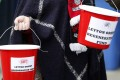 Leyton Orient fans collect money outside the ground. Photo: Reuters