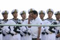 PLA Navy personnel are saluted by Philippines President Rodrigo Duterte as he tours a Chinese navy flotilla that docked in Davao City on a four-day goodwill visit, on May 1. Photo: EPA