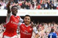 Arsenal's Danny Welbeck celebrates with teammate Alexis Sanchez after scoring in the 2-0 win over former club Manchester United. Photo: EPA