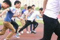 The male students racing in high heels. Photo: Youth.cn