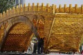 Workers install a 'Golden Bridge of Silk Road' on a platform outside the National Convention Centre in Beijing, the venue which hosted the Belt and Road Forum for International Cooperation last month. Photo: AP