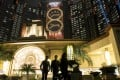 People walk past Studio City casino resort in Macau, developed by Melco Crown Entertainment. Photo: Bloomberg