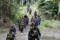 Filipino soldiers are patrol in the town of Ibanga, Bohol island, Philippines. Photo: EPA