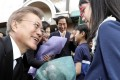Moon Jae-in is greeted by a young supporter as he leaves his private residence for the presidential Blue House in Seoul on May 10. Photo: EPA