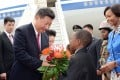 President Xi Jinping is greeted at Pretoria's Waterkloof Air Force Base at the start of a state visit to South Africa in December 2015. Photo: EPA