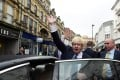 Britain's foreign secretary Boris Johnson waves as he leaves a campaign event in Newport Market, Wales. Photo: Reuters