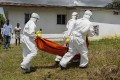 File photo of a Liberian Red Cross burial team retrieving a body during the 2014 outbreak. Photo: EPA