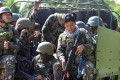 Philippine soldiers head to an area of unrest on Boho Island. Photo: EPA