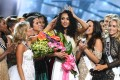 Miss District of Columbia Sara McCullough (centre) is surrounded by fellow contestants after she was crowned Miss USA 2017 at the Mandalay Bay Events Centre in Las Vegas on Sunday. Photo: AFP