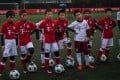 Chinese boys in Bayern Munich jerseys take part in a practise session after the opening ceremony of Bayern's office in Shanghai on March 22, 2017. AFP PHOTO / Johannes EISELE