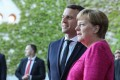 German Chancellor Angela Merkel (R) poses with visiting French President Emmanuel Macron in Berlin as both leaders pledge to push for a new Europe and to beat off the challenge of populists on the continent. Photo: Xinhua