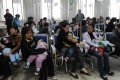 Chinese familes accompany their children as they get various injections from flu to rabies shots at a hospital in Hefei, central China's Anhui province. Photo: AFP