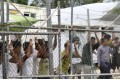 Asylum seekers behind a fence at the Manus Island detention centre, in Papua New Guinea. File photo: EPA