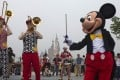 Mickey Mouse leads a marching band at the Shanghai Disney Resort. The park has announced that it has received 10 million visitors before its first anniversary. Photo: AP