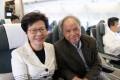 Carrie Lam with husband Lam Siu-por on a flight to Beijing. Photo: Sam Tsang