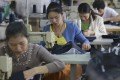 Workers at a factory in Jiujiang, in China's Jiangxi province, produce clothing destined for the EU.