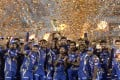 Mumbai Indians players hold the trophy as they celebrate their victory against Rising Pune Supergiant in the 2017 Indian Premier League. Photo: AFP