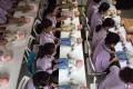 A file picture of women training to be a nannies in Beijing using plastic babies during one class. Photo: Getty Images