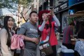 A South Korean guide directing tourists in the popular Myeongdong shopping area of Seoul. Photo: AFP