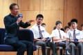 Former Legislative Council president Jasper Tsang shares his experiences in learning English and writing advice with about 800 secondary students and teachers, in Hong Kong last October 7. Photo: May Tse