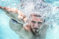 Man swimming in a pool. Photo: Shutterstock