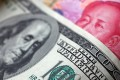 The yuan weakens against the US dollar Tuesday morning. Photo: Reuters