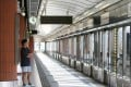 A passenger on the platform of the West Rail's Kam Sheung Road Station. Photo: May Tse