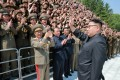 North Korean leader Kim Jong-un waves to scientists and technicians who helped develop his missile programme. Photo: Reuters