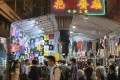 Cheap clothing and trinkets draw large crowds to the Ladies' Market in Tung Choi Street, Mong Kok. Photo: Alkira Reinfrank