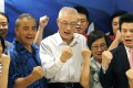 Wu Den-yih (centre) and his supporters declare victory in the election for Kuomintang chairman, in Taipei on May 20. Photo: AP