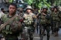 Philippine soldiers prepare for an assault. Photo: Xinhua