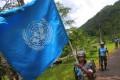 A Sri Lanka Air Force airman carries the UN flag during training for a road patrol. Photo: AP