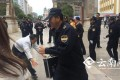 An urban enforcement official in Kunming laughs as a masseur tries to find a loudspeaker telling the public not to use his service. Photo: Yunnan.cn