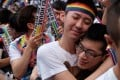 Activists celebrate outside a Taiwan court after its decision to allow same-sex marriage. Photo: AFP