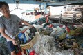 A Cheung Chau fisherman with marine littler. Pictures: SCMP
