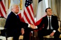 US President Donald Trump appears to ry unsuccessfully to break away from a handshake with French President Emmanuel Macron before a working lunch ahead of a Nato Summit in Brussels, Belgium, on Thursday. Photo: Reuters
