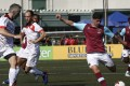Joe Powell from West Ham United (second right) strikes the ball against Yau Yee League Masters at the HKFC CITI Soccer Sevens. Photo: Jonathan Wong