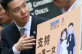 """Lawmaker Holden Chow Ho-ding (left) and members of DAB petition over """"safeguarding family values"""" in a response to the earlier judicial review from a gay civil servant over his husband benefits outside Central Government offices. Photo: David Wong"""